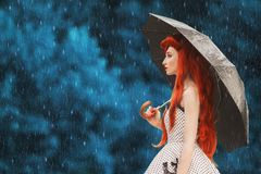 Raining cold weather. Autumn rain. Sick girl with virus in dress hold umbrella. Umbrella protection. Lonely woman with disease was royalty free stock image