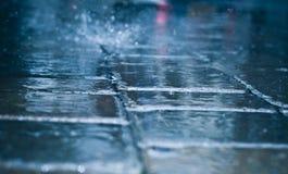 Raining day. Rough texture of wet block pavement steet , raining day Royalty Free Stock Photos