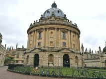 Raining day in oxford uk with a nice building very special holiday stock photography