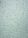 Raining droplets on on the windshield Stock Photos