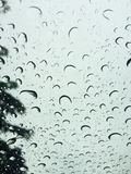 Raining droplets on on the windshield Royalty Free Stock Photography