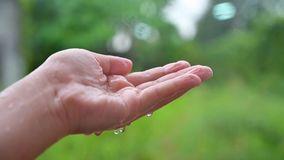 Raining drops of water flowing into the hands hd Slow 120 frames. Raining drops of water flowing  into the hands hd Slow 120 frames stock video footage