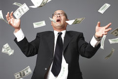 Raining hundred dollar bills Stock Image