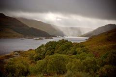 Raining on the lake Stock Images