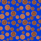 Raining Lucky Pfennig Coins. The German one Pfennig coin, symbol of good luck, as seamless pattern on blue background Royalty Free Stock Photography