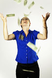 Raining Money. An attractive woman catching falling money Stock Photography