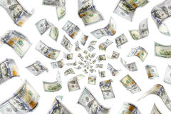 Raining Money. Raining 100 dollar bills on a white background Royalty Free Stock Images