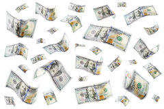 Raining Money. Floating 100 dollar bills on a white background Royalty Free Stock Photos