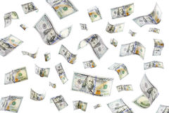 Raining Money. Floating 100 dollar bills on a white background Royalty Free Stock Images