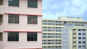 Raining over apartments was shot 50FPS, Rain over the city and Lightning, beige building with balconies. Singapore Raining over apartments was shot 50FPS, Rain stock footage