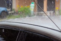 Raining on the roof of the car. Conception about raining season Stock Photography