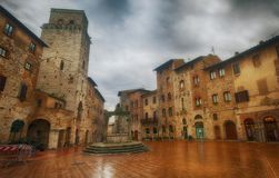 Raining in San Gimignano, Tuscany. Raining in the small but pitoresque medieval town San Gimignano in Tuscany, Italy. Central square Stock Images