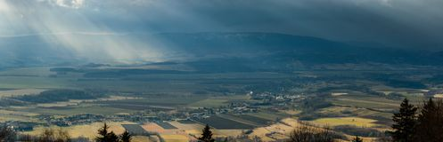 Raining sunbeams between storm clouds over a mountain range. Poland, Raining sunbeams between storm clouds over a mountain range europe sudety jagodna valley royalty free stock images