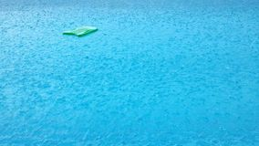 Raining at swimming pool. With swimming board stock video