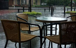 Raining terrace. A street terrace after rain in an spring day Royalty Free Stock Photography