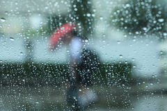 Raining and umbrella. Watching people gone by while is raning Stock Photos