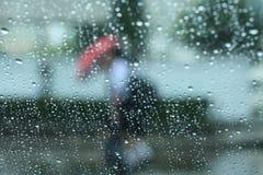 Raining and umbrella Stock Photos