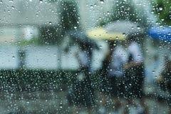 Raining and umbrella Royalty Free Stock Photos