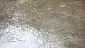 Raining Water Drops On Empty Cement Ground stock video footage
