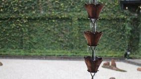 Raining waters way-out in zen garden stock video footage