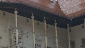 Raining at Wavel Castle. Medium shot of colonnade of the famous Wavel Castle, in Krakow, Poland, while raining stock video