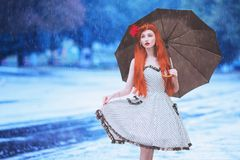 Raining weather. Autumn rain. Sad girl in sorrow in dress hold umbrella. Umbrella protection against street. Lonely woman with royalty free stock photos