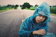 Raining with women on the road Royalty Free Stock Photography