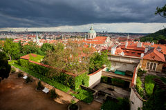 Rainly clouds over the old houses and gardens Royalty Free Stock Photography