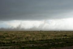 Rainstorm from a dark funnel cloud stock photos