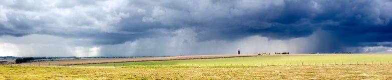 Rainstorm over Meadows Panorama Stock Photo