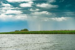 The rainstorm seen from the lake Royalty Free Stock Photos