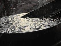 Rainwater Barrel. Rainwater overflowing in garden barrel Royalty Free Stock Photo