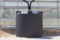 Rainwater Collection System. A couple of rain water collection tanks used to catch rain water off of a greenhouse Stock Photo