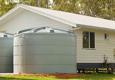 Rainwater conservation tanks on new house. Australian building rainwater conservation tanks for water supply on new house in rural region Royalty Free Stock Photo