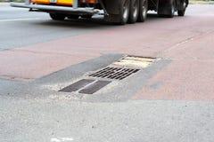 Rainwater drain on the road Stock Photos