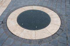 Rainwater drainage grate. Drainage system of rain Royalty Free Stock Photography