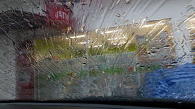 Rainwater flows through the windshield stock video footage