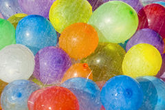 Rainwater over colored balloons. Water drops falling over multicolored water filled balloons Stock Images