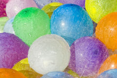 Rainwater over colored balloons. Rainwater falling over water filled colored balloons Stock Photography
