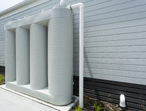 Rainwater tank. Rainwater collection tank besides a modern house Royalty Free Stock Photos