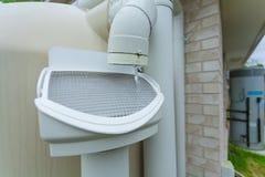 Rainwater tank. Rainwater running off roof into rainwater tank Royalty Free Stock Photos