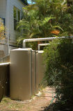 Rainwater tanks. A tank that collects rain water running from the gutter. Rainwater tanks are a very important feature in Australia where water is scarce Stock Photography