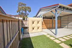 Rainwater Watertank Carport. A carport and rainwater collection tank Royalty Free Stock Photo