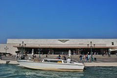 Rainway station. The parking of a water taxi near the railway station of Venice stock photography