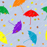 Rainy autumn background with umbrellas and leaves Stock Images