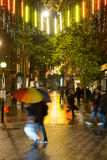 Rainy Autumn Evening in Seven Dials London. People rushing through the rain at Seven Dials London close to Covent Garden on a dark autumn evening Stock Photos