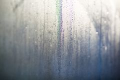 Flowing down water drops on window glass Stock Photos