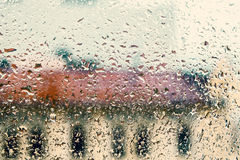 Rainy background with flowing down water drops on window Stock Photos