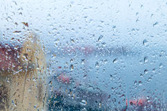 Rainy background, water drops on the window glass Stock Photos