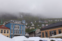 A Rainy Bergen  and Misty Hillside Stock Image